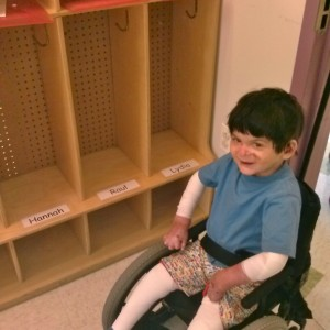 Raul next to his cubby!