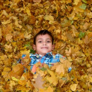 Samuel playing in the leaves!