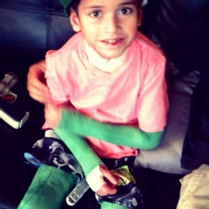 Samuel with green bandages.